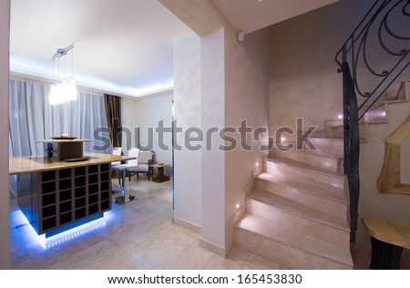 staircase and kitchen in modern apartment - stock photo