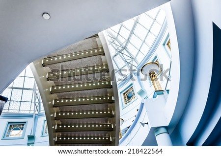 Staircase and large glass dome in Towson Town Center, Maryland. - stock photo