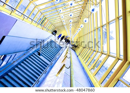 staircase and yellow glass corridor