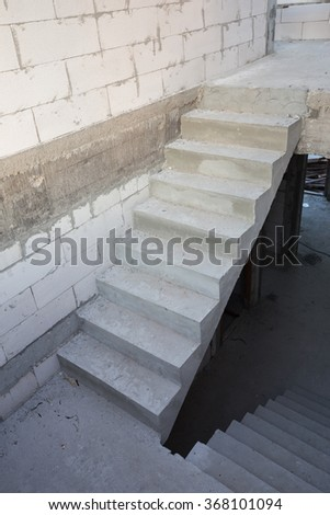 staircase cement concrete structure in residential house building at construction site - stock photo