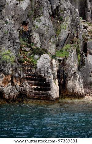 Staircase heading to the water at the sunken city of Kekova near Antalya, Turkey - stock photo