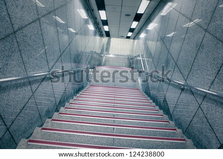 Staircase in underground passage with blue tone - stock photo