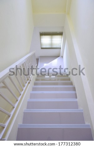 Staircase interior at white home - stock photo