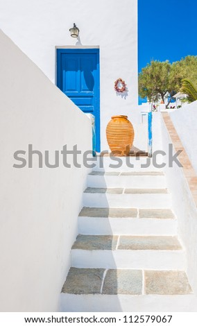 Staircase leading to an entrance with ceramic vase from the beautiful island of Sifnos, Greece