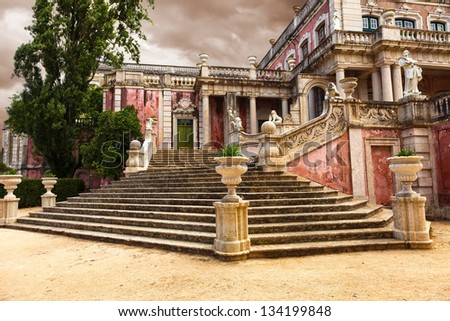 Staircase of the Robillon wing in Queluz National Palace, municipality of Sintra, Lisbon district, Portugal. Their design creates an illusion of a longer and higher perspective - stock photo