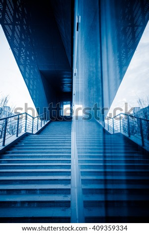 staircase reflected in glass wall,blue toned image. - stock photo