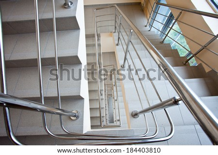 staircase with metal railing in the business center