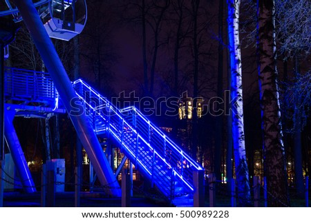 Staircase with neon lights on the railing