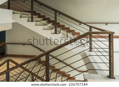staircase with wooden rail in a modern building - stock photo