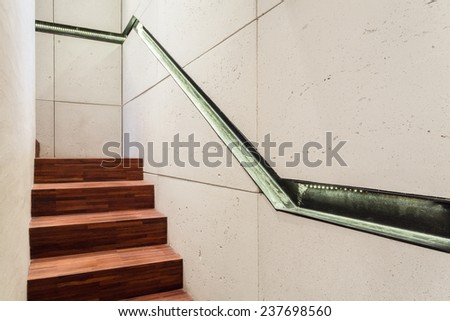 Staircase with wooden stairs and industrial elements - stock photo