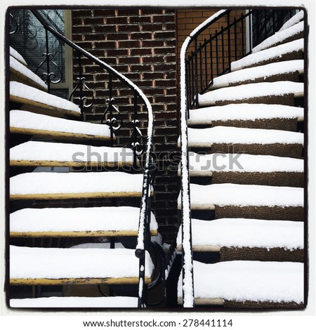 Staircases covered by snow. Winter in Montreal, Canada. - stock photo