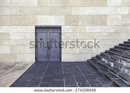 Stairs and door in modern building - stock photo