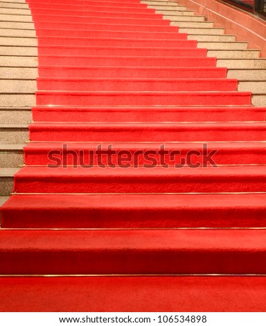Stairs covered with red carpet - stock photo