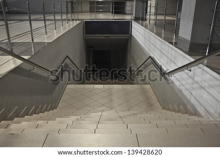 Stairs descending from subway station - stock photo