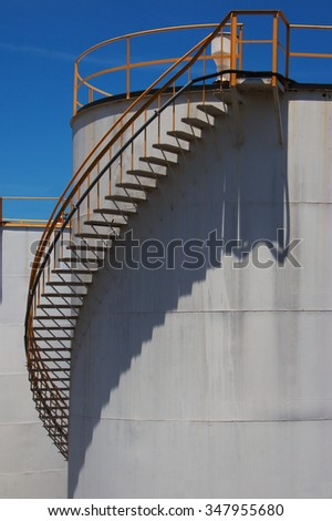 Stairs detail from a storage tank in the port - stock photo
