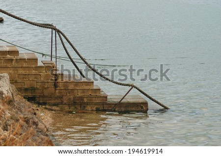 stairs down to the shore of the estuary