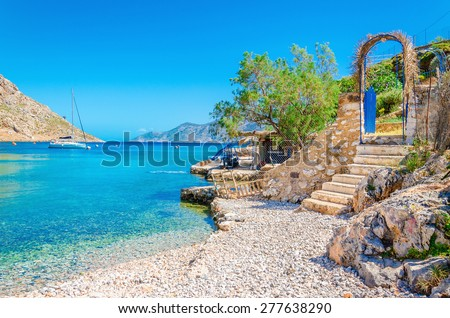 Stairs from sandy beach of amazing bay on Greece island Kalymnos, Greece - stock photo