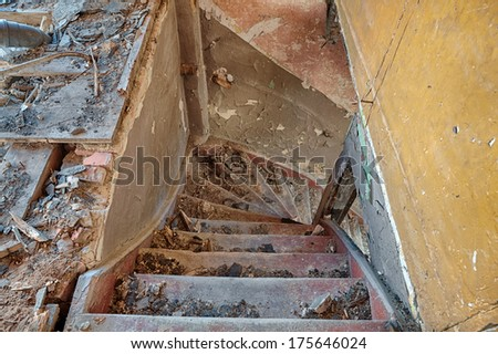 Stairs from the attic of a ruined building - stock photo
