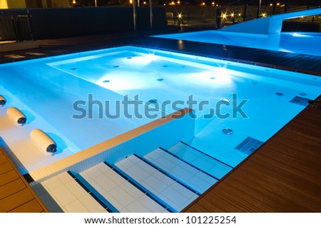 stairs in a small swimming pool at night - stock photo