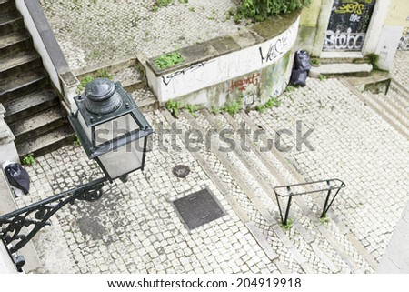 Stairs in Alfama district, Lisbon, detail of a old sclera in a typical neighborhood - stock photo