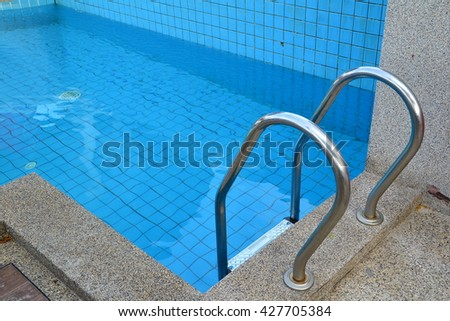 Luxury swimming pool blue water wooden stock photo - How to make swimming pool water blue ...