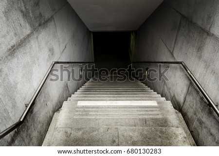 Stairs of an access to an underground tunnel, detail of stairs for pedestrians