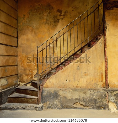Stairs of old yellow house. Background - stock photo