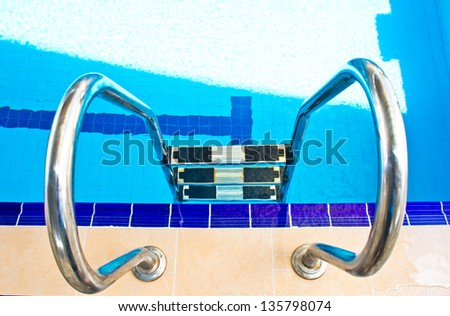 Stairs of the empty swimming pool in university - stock photo