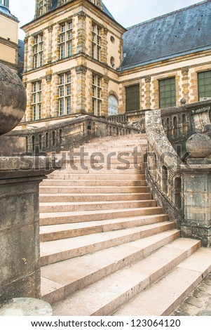 Stairs of the Palace of Fontainebleau, one of the largest French royal chateaux - stock photo
