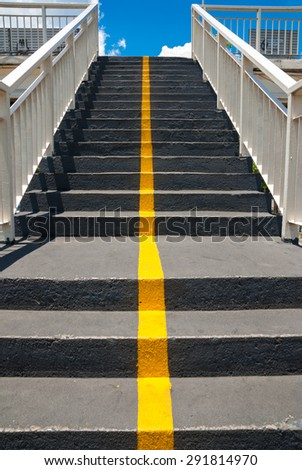 Stairs of the pedestrian overpass in the city. - stock photo