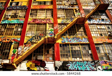 Stairs on a building covered in graffiti - stock photo