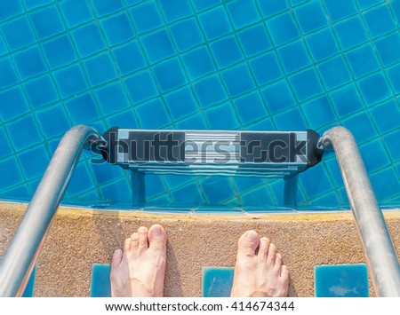 Stairs pool in the swimming pool with foot - stock photo
