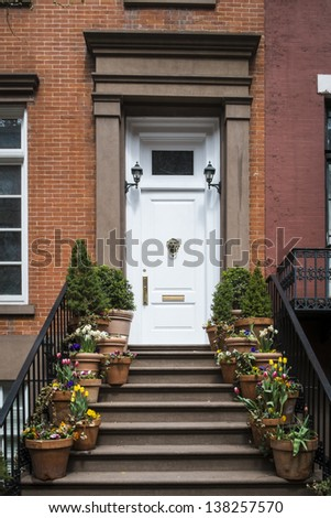 Stairs to a doorway of an old apartment, Manhattan, New York City - stock photo
