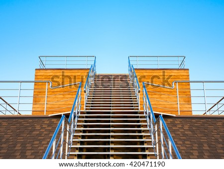 Stairs to the tribune or podium on a background of blue sky.                                - stock photo