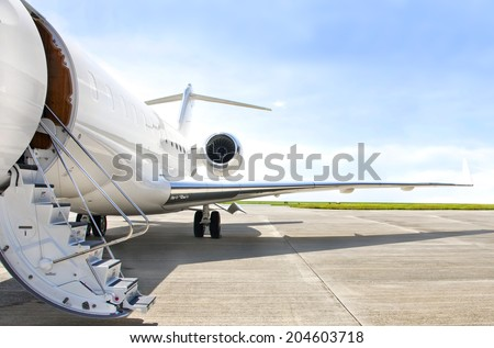 Stairs with Jet Engine on a modern private jet airplane  - stock photo
