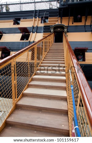 Stairway leading up to the ship with cannons