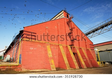 Stairway on red brick wall on clear blue sky horizontal - stock photo