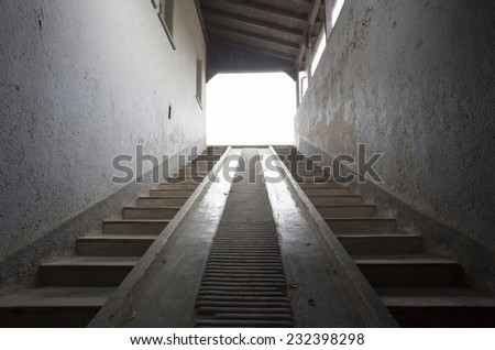 stairway up to the light in old building - stock photo