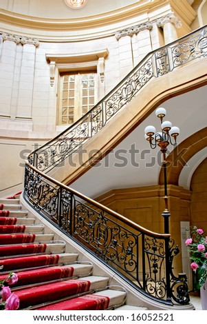 Stairwell in  Polish palace. An old architecture. red carpet.