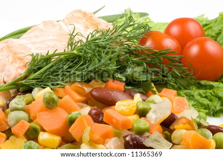 Stake from a salmon with vegetables on a plate