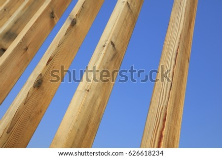 Stakes in blue sky background