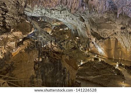 stalactites and stalagmites in valporquero cave - stock photo