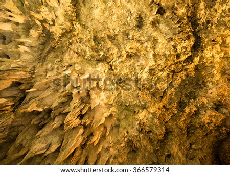 Stalactites in cave - stock photo