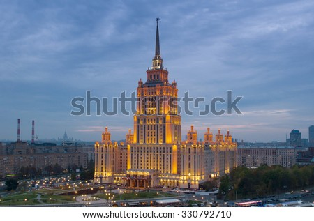 Stalin skyscraper - Ukraine Hotel with illumination at morning in Moscow
