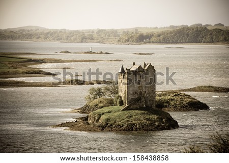 Stalker Castle, Loch Linnhe, Appin, Scotland. Vintage style processing. - stock photo