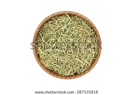 stalks of dried rosemary in a wooden bowl on a white background