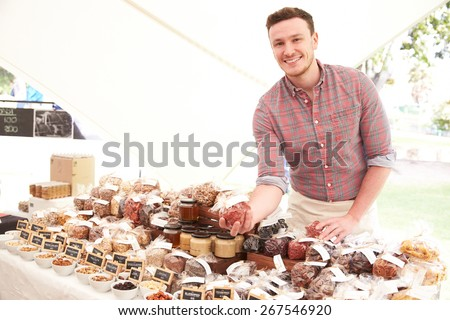 Stall Holder At Farmers Food Market Selling Nuts And Seeds - stock photo