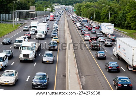 Stamford, CT - June 6, 2014: Scene of heavy traffic on the interstate highway in Stamford Connecticut on June 6, 2014.  - stock photo