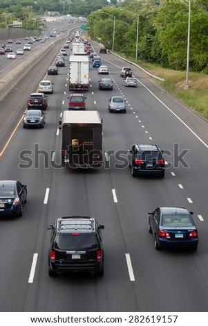 Stamford, CT - May 29, 2015: Daytime traffic on the interstate highway on May 29, 2015 in Stamford Connecticut