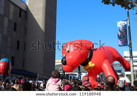 STAMFORD, CT - NOVEMBER 18, 2012: Clifford floating above the crowds in the UBS Parade Spectacular on November 18, 2012 in Stamford, CT